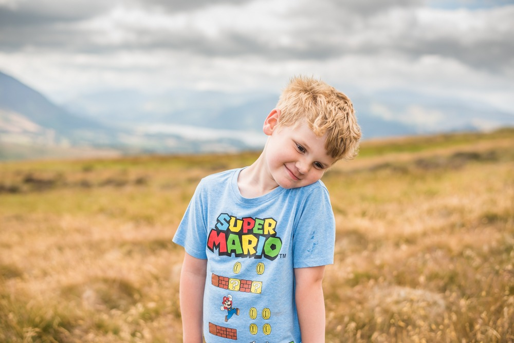 Stan posing on fell, Lake District photographers