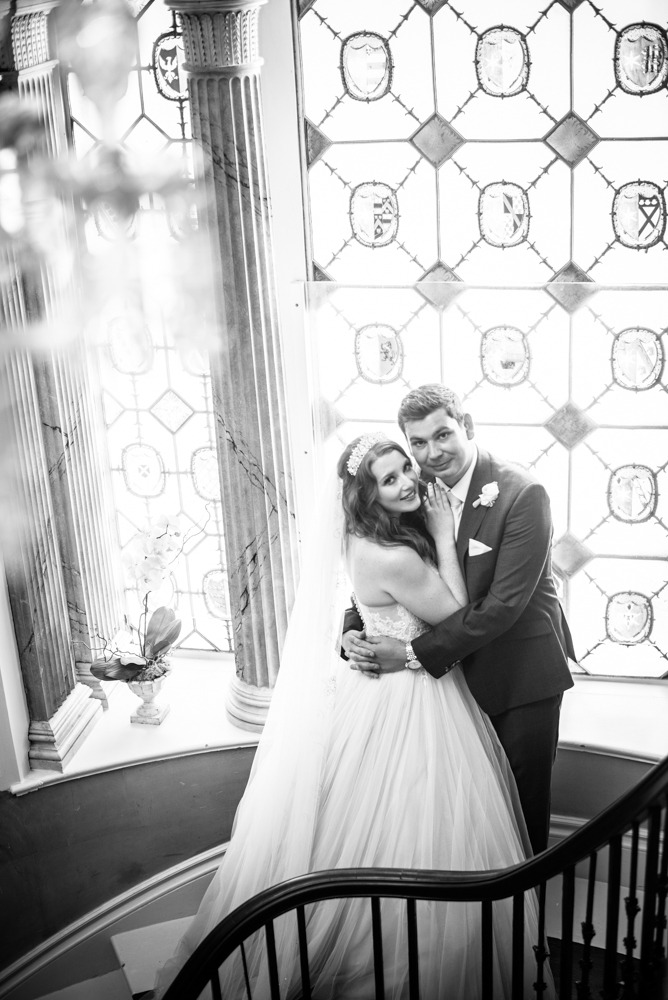 Bride and groom cuddling on stairs, Ripley Castle weddings, Yorkshire wedding photographers