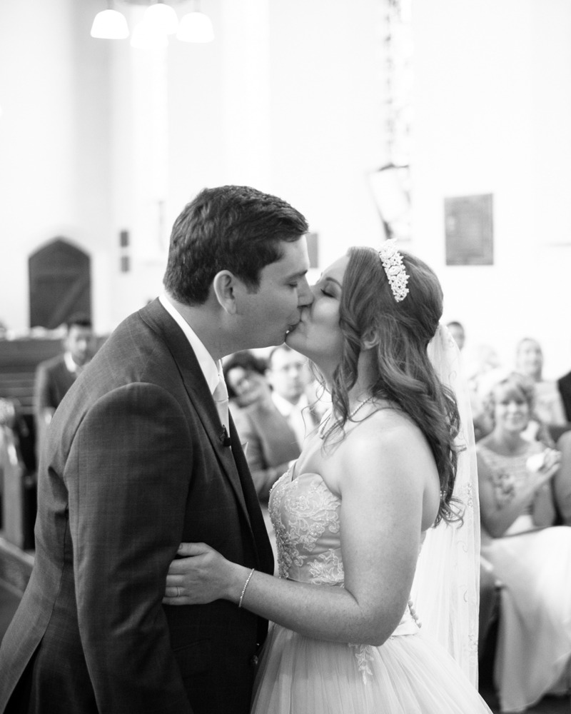 Bride and groom kiss in church, Burley in Wharfedale church, Yorkshire wedding photographers