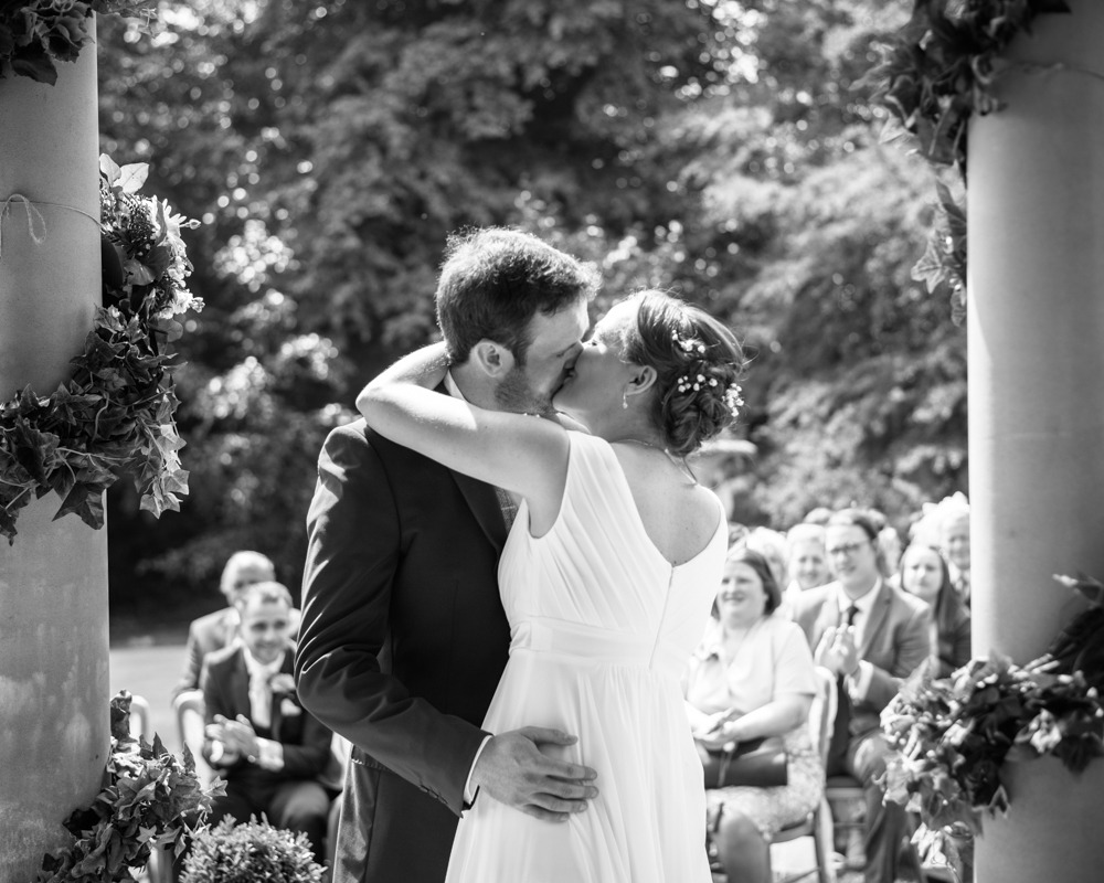 Bride and groom first kiss outdoor ceremony, Ringwood Hall weddings, Sheffield wedding photographer