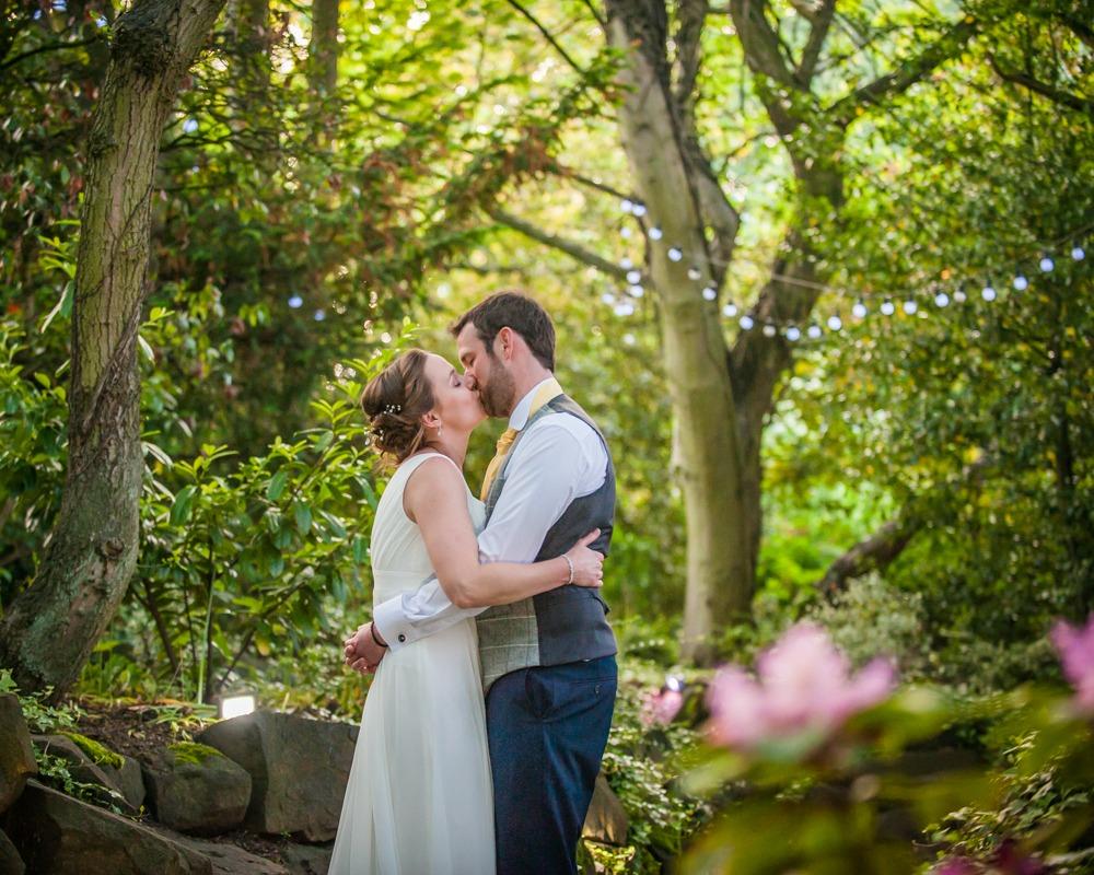 Bride and groom kissing in secret garden, Ringwood Hall weddings, Sheffield wedding photographer