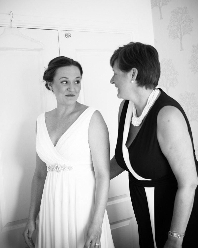 Bride and her Mum sharing a look as she gets on her dress, Ringwood Hall weddings, Sheffield wedding photographer