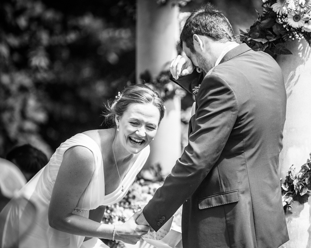 Bride laughing with groom in ceremony, Ringwood Hall weddings, Sheffield wedding photographer