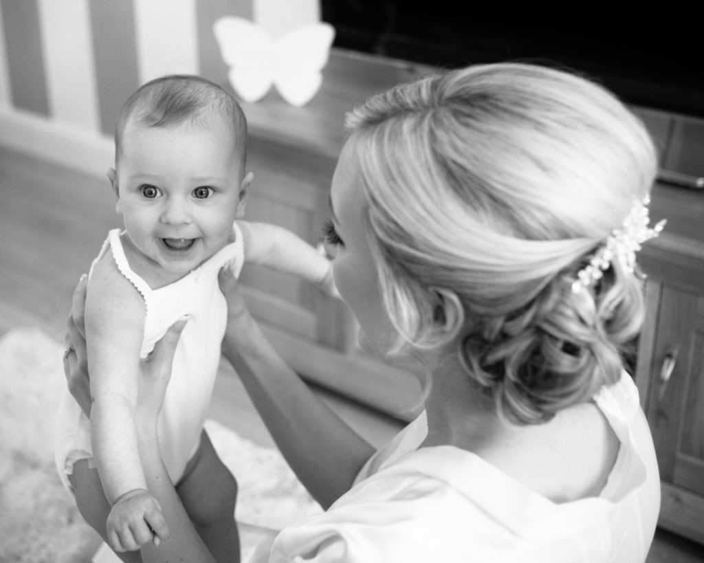 Bride and her daughter cuddles, Wortley Hall, Sheffield wedding photography