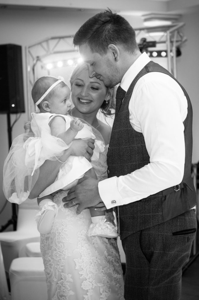 Bride and groom dancing with their daughter, Wortley Hall, Sheffield wedding photography