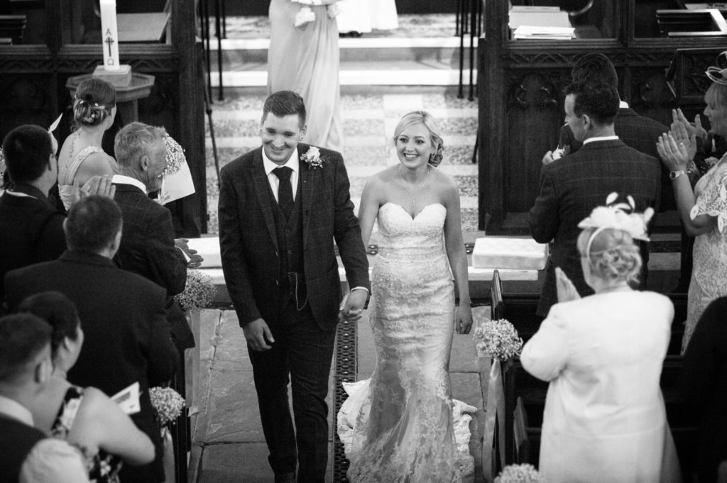 Bride and groom walking down aisle in church, Wortley Hall, Sheffield wedding photography